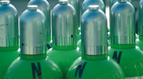 Steel cylinders (colour green) and letter 'N'. View of the cylinder tops with caps.